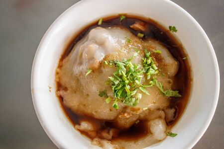 A bowl of large Taiwanese pork dumpling with onions. Stock Photo