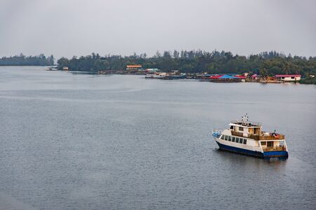 View of Mengkabong river with boats and houses seen in the morning.