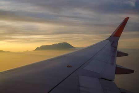 View of Mount Kinabalu from an air plane window at dawn.
