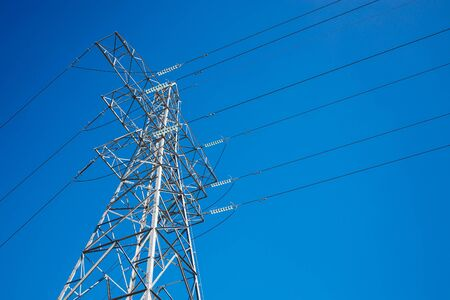 Pylon and High Voltage Powerline with a Background Blue Sky