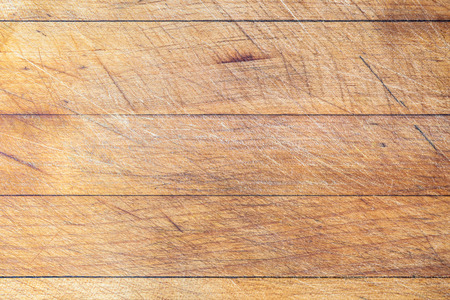 Rough wooden used cutting board background with horizontal lines and cutting traces Stock Photo