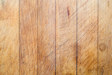 vertical lines: Rough wooden used cutting board background with vertical lines and cutting traces