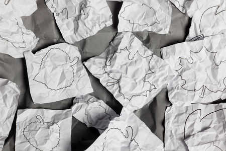 creasy: Dark grey background with black and white contour paper leaves