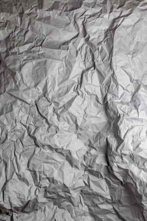 photography backdrop: Dark grey crumpled paper background vertical composition Stock Photo