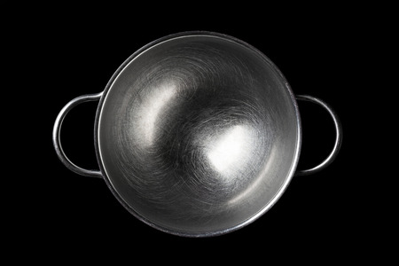 directly: Stainless steel bowl on black background directly from above Stock Photo