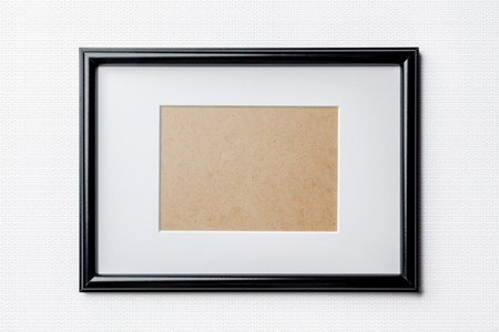 passepartout: Black plain empty thin wood picture frame with white mat passe-partout on white bricks background