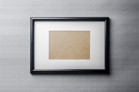 passe: Black plain empty thin wood picture frame with white mat passe-partout on grey bricks background