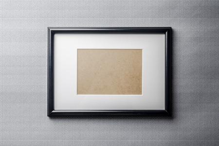 passepartout: Black plain empty thin wood picture frame with white mat passe-partout on grey bricks background