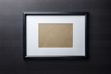 passe: Black plain empty thin wood picture frame with white mat passe-partout on black bricks background