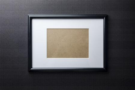passepartout: Black plain empty thin wood picture frame with white mat passe-partout on black bricks background