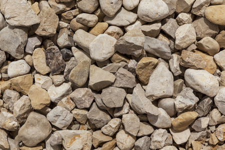 directly: Grey yellow brown black natural boulders background directly from above