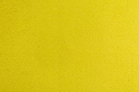 eva: Eva foam ethylene vinyl acetate yellow surface sponge plush background Stock Photo