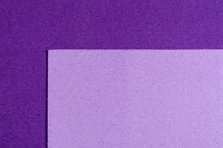 eva: Eva foam ethylene vinyl acetate light purple surface on purple sponge plush background Stock Photo