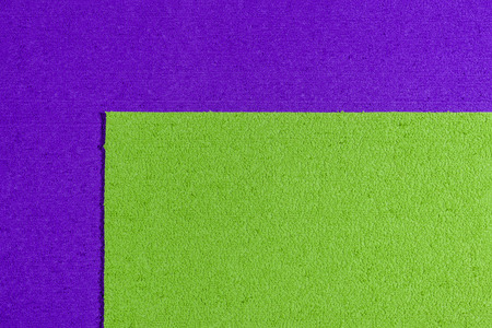 acetate: Eva foam ethylene vinyl acetate apple green surface on purple sponge plush background