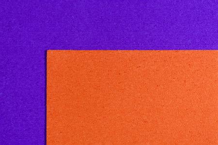 ethylene: Eva foam ethylene vinyl acetate orange surface on purple sponge plush background Stock Photo