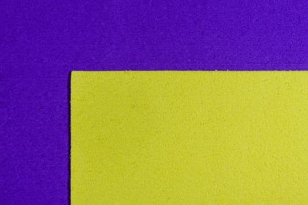 acetate: Eva foam ethylene vinyl acetate lemon yellow surface on purple sponge plush background