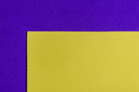 eva: Eva foam ethylene vinyl acetate smooth lemon yellow surface on purple sponge plush background Stock Photo