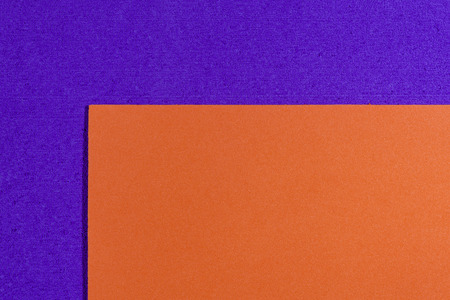 acetate: Eva foam ethylene vinyl acetate smooth orange surface on purple sponge plush background
