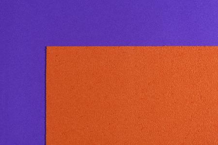 ethylene: Eva foam ethylene vinyl acetate sponge plush orange surface on purple smooth background Stock Photo