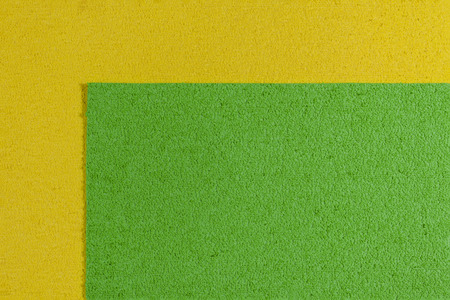 acetate: Eva foam ethylene vinyl acetate apple green surface on lemon yellow sponge plush background