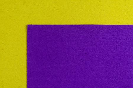 ethylene: Eva foam ethylene vinyl acetate purple surface on lemon yellow sponge plush background Stock Photo