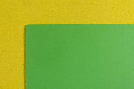 eva: Eva foam ethylene vinyl acetate smooth apple green surface on lemon yellow sponge plush background
