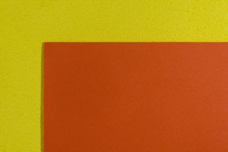 acetate: Eva foam ethylene vinyl acetate smooth orange surface on lemon yellow sponge plush background