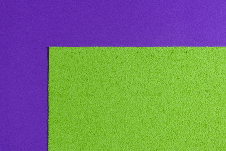 eva: Eva foam ethylene vinyl acetate sponge plush apple green surface on purple smooth background