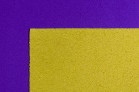 acetate: Eva foam ethylene vinyl acetate sponge plush lemon yellow surface on purple smooth background