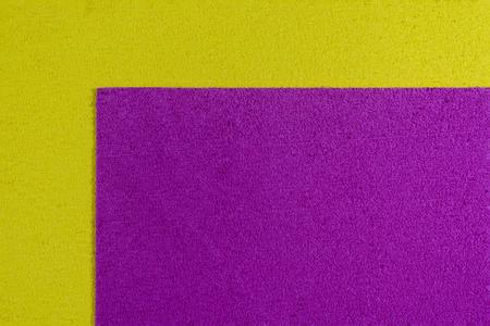 eva: Eva foam ethylene vinyl acetate pink surface on lemon yellow sponge plush background Stock Photo