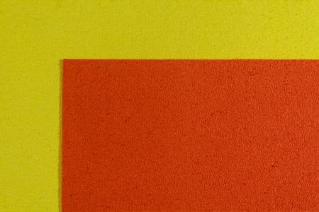 ethylene: Eva foam ethylene vinyl acetate orange surface on lemon yellow sponge plush background Stock Photo
