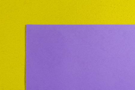 ethylene: Eva foam ethylene vinyl acetate smooth light purple surface on lemon yellow sponge plush background Stock Photo