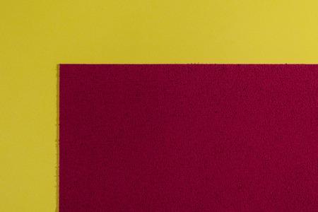 acetate: Eva foam ethylene vinyl acetate sponge plush red surface on lemon yellow smooth background