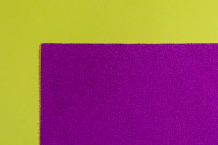 acetate: Eva foam ethylene vinyl acetate sponge plush pink surface on lemon yellow smooth background