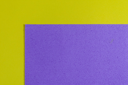 ethylene: Eva foam ethylene vinyl acetate sponge plush light purple surface on lemon yellow smooth background Stock Photo