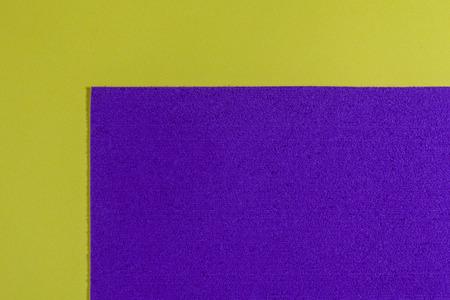 eva: Eva foam ethylene vinyl acetate sponge plush purple surface on lemon yellow smooth background
