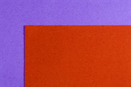 ethylene: Eva foam ethylene vinyl acetate orange surface on light purple sponge plush background Stock Photo