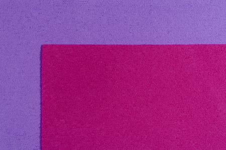 eva: Eva foam ethylene vinyl acetate pink surface on light purple sponge plush background Stock Photo