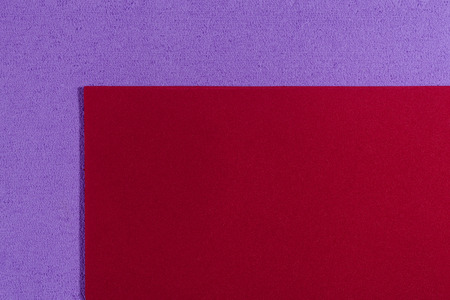 eva: Eva foam ethylene vinyl acetate smooth red surface on light purple sponge plush background Stock Photo