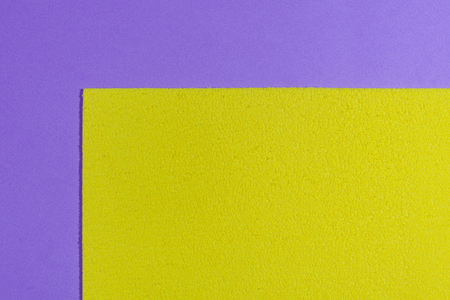 eva: Eva foam ethylene vinyl acetate sponge plush lemon yellow surface on light purple smooth background