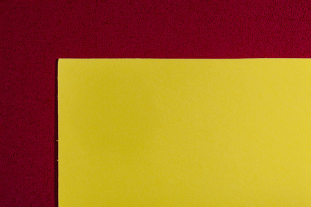 ethylene: Eva foam ethylene vinyl acetate smooth lemon yellow surface on red sponge plush background