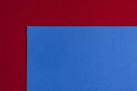ethylene: Eva foam ethylene vinyl acetate smooth blue surface on red sponge plush background Stock Photo