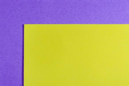 acetate: Eva foam ethylene vinyl acetate smooth lemon yellow surface on light purple sponge plush background
