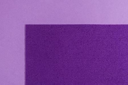 eva: Eva foam ethylene vinyl acetate sponge plush purple surface on light purple smooth background Stock Photo