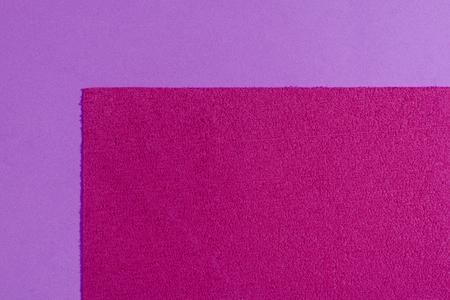 acetate: Eva foam ethylene vinyl acetate sponge plush pink surface on light purple smooth background