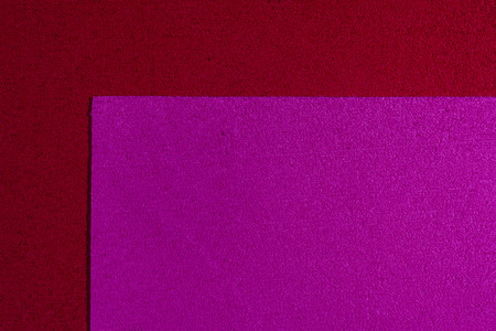 eva: Eva foam ethylene vinyl acetate pink surface on red sponge plush background