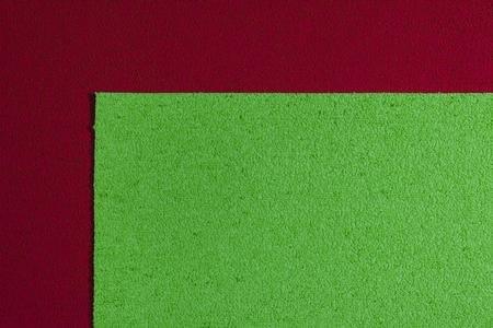 ethylene: Eva foam ethylene vinyl acetate apple green surface on red sponge plush background Stock Photo