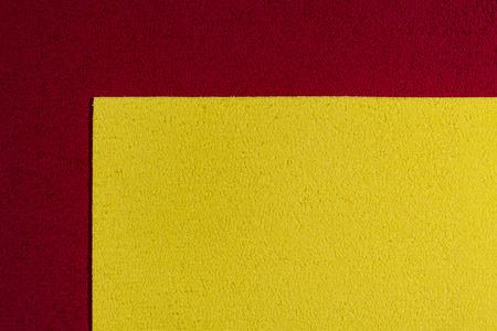 acetate: Eva foam ethylene vinyl acetate lemon yellow surface on red sponge plush background