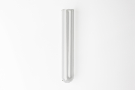 Glass transparent test tube on white background