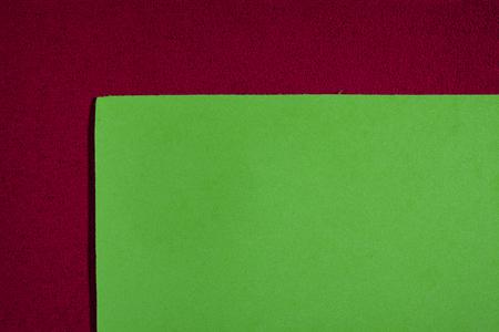 ethylene: Eva foam ethylene vinyl acetate smooth apple green surface on red sponge plush background